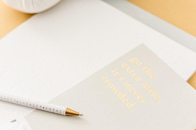 My 4 Step Website Design Process a notebook and pen on a desktop