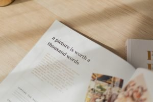 Secrets to Image Optimization an open magazine on a wood table