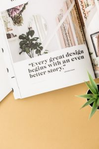 10 Tips for an Effective About Page an open book on a desk with a plant