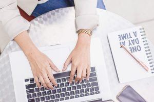 5 Reasons Fresh Content is Important for Your Website a woman wearing a gold watch typing on a laptop