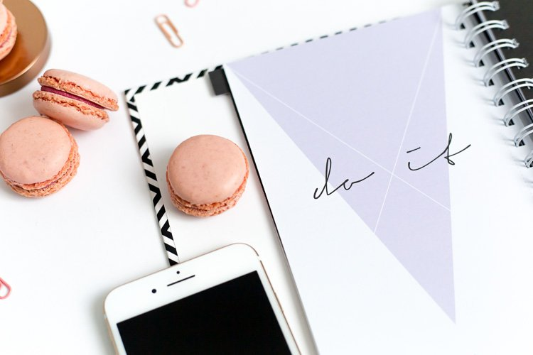 Why Your Website Needs a Call to Action a notebook that says do it with a cell phone and macarons