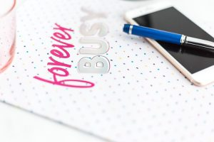 6 Tips for an Effective Contact Page a notebook, pen and cell phone