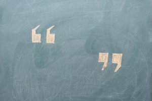 Client Testimonials two quotes on a chalkboard