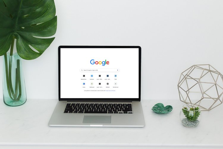SEO Tips and Tricks Laptop with Google Search Page open